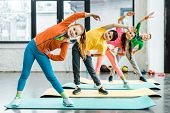Smiling preteen kids doing sport exercise together poster