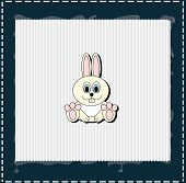 There is a rabbit on white frame with blue edges for christmas or easter poster