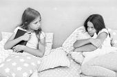 She dont want to share her book. Sisters rivalry concept. Sisters relations issues. Share book with friend. Children in bedroom want read evening fairy tale. This is my book. Girlish rivalry. poster