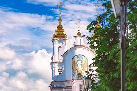 Beautiful Old Orthodox Church Belfry In Vitebsk, Belarus, Europe. Blue Cloudy Sky In Background.