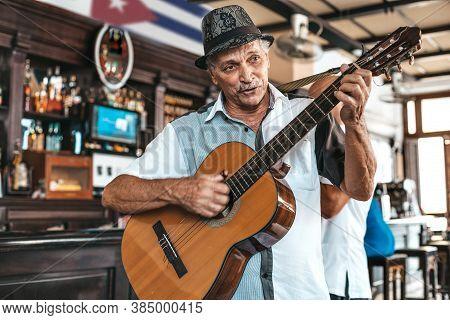 Havana, Cuba - October 18, 2019: Cuban Band Performing Live Music In A Bar (dos Hermanos) In Havana,