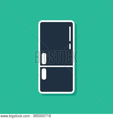 Blue Refrigerator Icon Isolated On Green Background. Fridge Freezer Refrigerator. Household Tech And