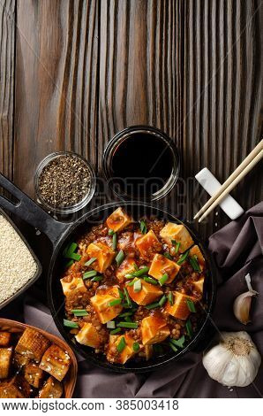 Mapo Tofu In Cast Iron Skillet With Pork Chopped Chives Soy Sauce Sichuan Pepper Garlic And Spices C