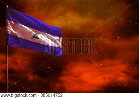 Fluttering Nicaragua Flag Mockup With Blank Space For Your Data On Crimson Red Sky With Smoke Pillar