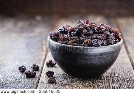 Crystallized And Dehydrated Dry Grapes, Christmas Dessert Inside A Clay Pot, Rustic Wooden Backgroun