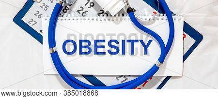 Obesity Word On Medical Desk, Inscription, Top View