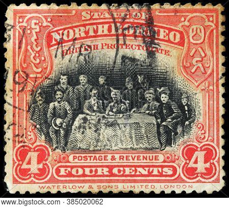 Luga, Russia - April 10, 2020: A Stamp Printed By North Borneo Shows Signing Treaty With Sultan Of S