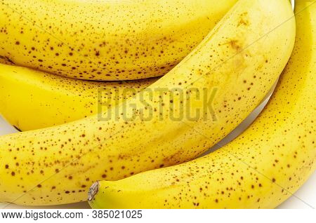 Spotted Bananas. Ripened Untreated Cavendish Bananas Full Frame Background.