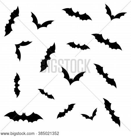 Silhouettes Of Flying Bats Isolated On White Background. Flock Of Flying Foxes. Vector Illustration