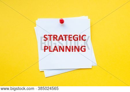 Strategic Planning. Word On White Sticker With Yellow Background
