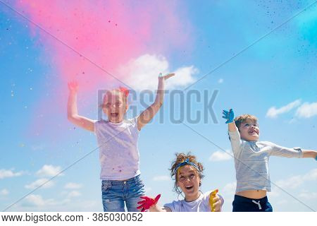 Bright Summer Colors. Adorable Little Kids With Colored Powder And Color Dust Splash