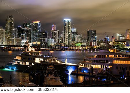 Port Miami Florida. Miami Florida At Sunset, Skyline Yacht Or Boat Next To Miami Downtown