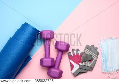 Pair Gloves, Blue Neoprene Mat,  Medical Face Mask And A Pair Of Dumbbells. Sports Concept During Ep