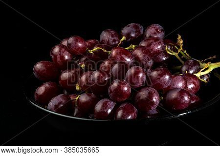Close Up Of A Red Grapes On A Black Background