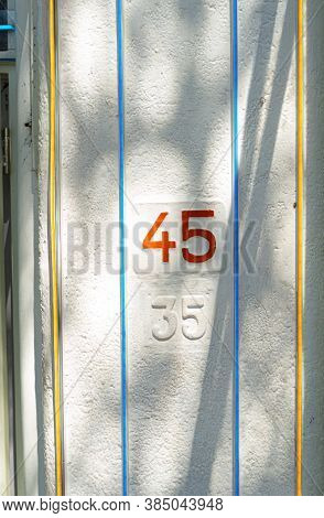 Bandung/indonesia - August 2020: Street Numbers Of A Coffee Shop In A Street That Revitalize Old Bui
