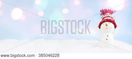 Happy Snowman Standing In Winter Christmas Landscape. Christmas Background. Merry Christmas And Happ