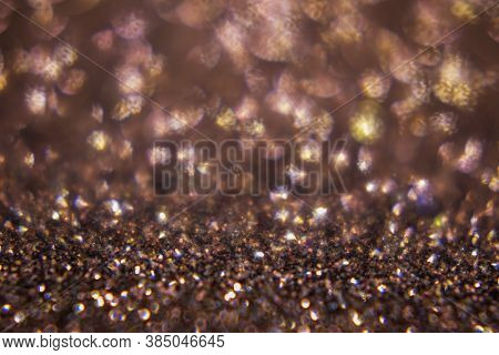Bokeh, Defocus Background. Vivid Bokeh That Goes From Brown To Silvery White To Gold. Festive Backgr