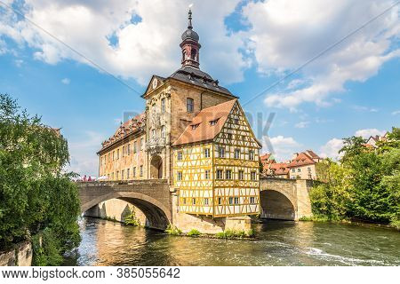 Bamberg,germany - August 09,2020 - View At The Old Town Hall With Bridge Over Regnitz River In Bambe