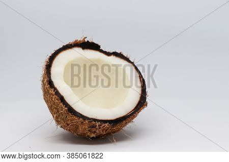 Coconut Isolated On The White Background, Halved Coconut On A White Background
