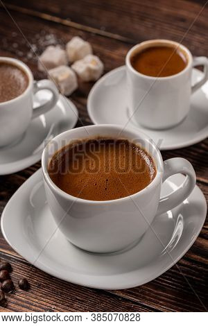 Traditional Greek - Turkish Coffee Cup And Turkish Delight Concept With Wooden Background