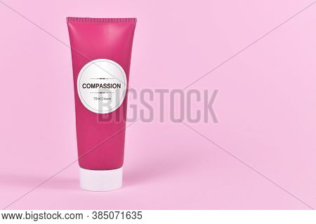 Compassion Concept With Cream Tube With Made Up Label Saying 'compassion, 75ml Cream' On Pink Backgr