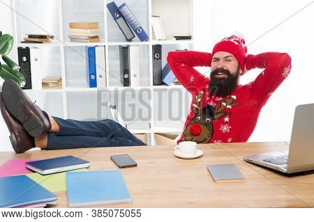 Celebrate Holiday Season In Style. Bearded Man Smile With Winter Look. Happy Hipster Relax At Workpl