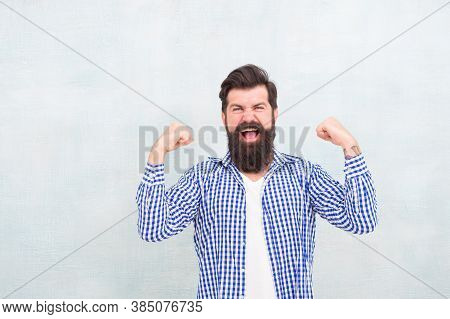 Power Of Success. Happy Hipster Keep Arms Upward Fingers Clenched. Bearded Man Celebrate Victory. Ba