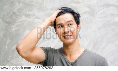 Asian Young Man Slicks His Hair Back.