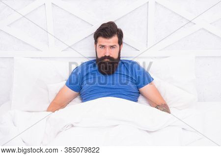 Brutal Male Spending Time In Room. Relax Lifestyle Concept. Bearded Man In Bed. Wake Up At Morning.
