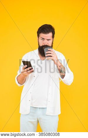 Hot Beverage In Paper Cup. Modern Life. Serious Guy With Moustache And Beard Drink Coffee Holding Sm