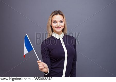 Immigration And The Study Of Foreign Languages, Concept. A Young Smiling Woman With A France Flag In