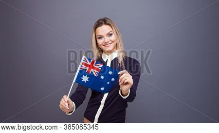 Immigration And The Study Of Foreign Languages, Concept. A Young Smiling Woman With A Australia Flag