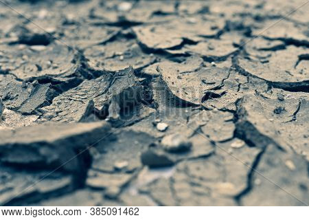 Parched Ground Close Up, Copy Space. Cracks On The Surface Of The Earth. Lack Of Moisture, Lack Of W
