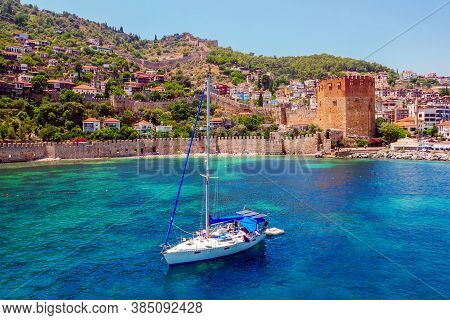 White Yacht In The Sea Bay. Harbor Of The Red Tower Alanya, Turkey. Holidays At Sea. The Coast Of Tu