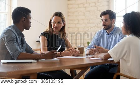 Multiracial Colleagues Talk Brainstorm At Office Briefing