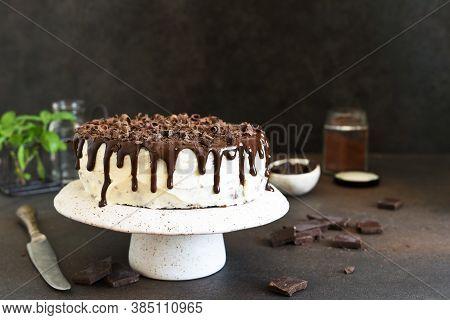 Chocolate Truffle Cake With Cream Cheese On A Dark Background.