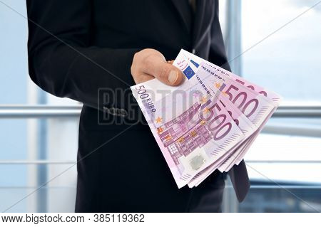 A Businessman Holding Money - Euro (500 Eur)