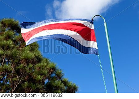 Costa Rica Flag Waving On The Wind, Blue Sky