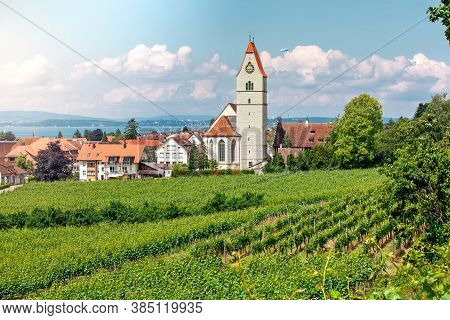 Panoramic View Of Lake Of Lake Constance. Zeppelin, Apple Trees And Catholic Church St. Johann Bapti