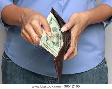 Person Holding Wallet With Money