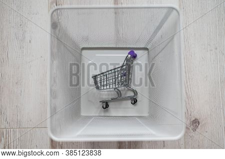 Top View Of A Miniature Grocery Basket In A Wastepaper Basket