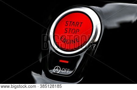 Car Dashboard With Focus On Red Engine Start Stop Button. Modern Car Interior Details. Start/stop Bu