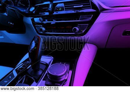 Modern Luxury Car White Leather Interior With In Blue And Pink Tones. Part Of Leather Car Seat Detai