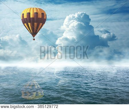 Dream World. Hot Air Balloon In Cloudy Sky Over Misty Sea