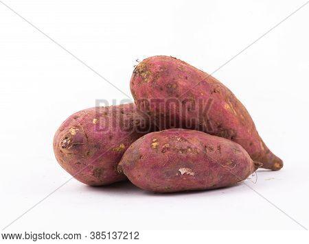 Fresh Sweet Potatoes On The White Background