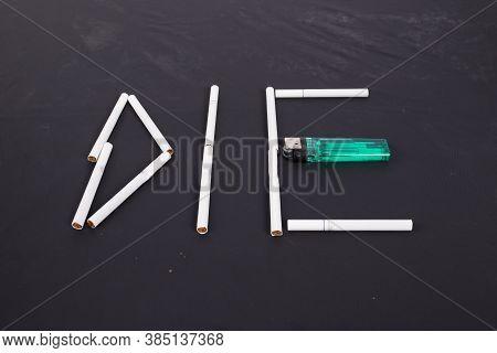 Cigarette  Arrange To The Word Die On Black Background