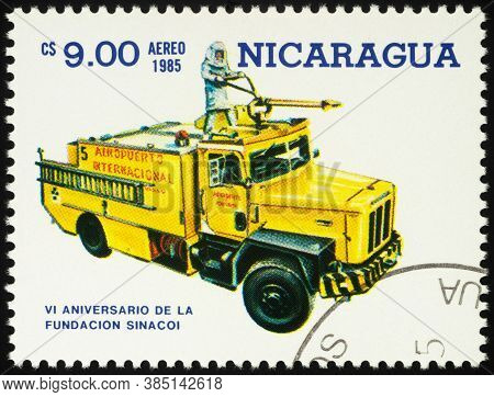 Moscow, Russia - September 13, 2020: Stamp Printed In Nicaragua Shows Yellow Fire Rescue Engine, Cir