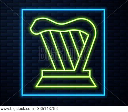 Glowing Neon Line Harp Icon Isolated On Brick Wall Background. Classical Music Instrument, Orhestra