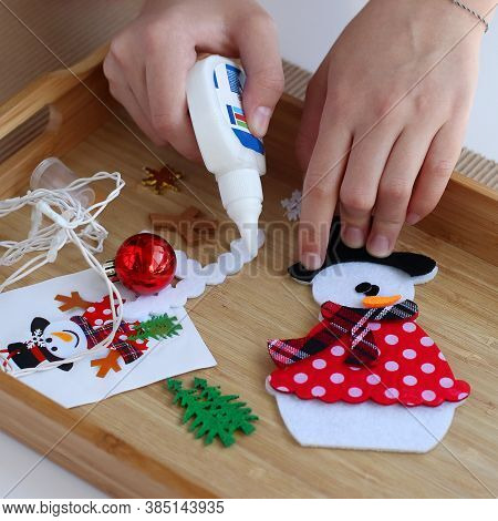 Getting Ready For Christmas. Children's Hands Collect Christmas Tree Toy Snowman. Tools For Work Are