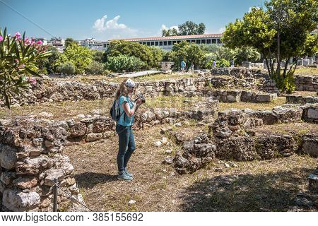 Female Person Visits Ancient Agora In Athens, Greece. It Is Tourist Attraction Of Athens. Young Pret